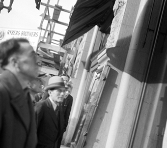 July 1938 Man looking at bank notice in window